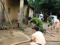 Bewohner stabilisieren das Leben nach Taifun und Fluten
