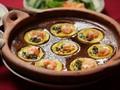 Savory mini-pancakes with pork and shrimp toppings