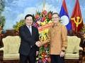 ผู้นำพรรคและรัฐเวียดนามอวยพรผู้นำพรรคและรัฐประเทศลาวในโอกาสเทศกาลบุญปีใหม่