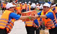 洪水被害者支援運動広がる