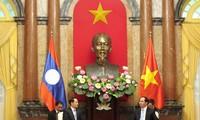 President Tran Dai Quang appreciates Vietnam, Lao cooperative orientations