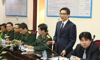Deputy PM Vu Duc Dam works with People's Army newspaper