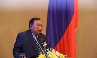 加强越老两党和两国合作
