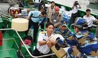 中央和地方的跨部门工作代表团探访庆和省长沙岛县