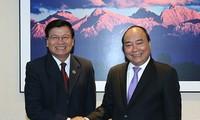 Premierminister Nguyen Xuan Phuc trifft Laos Premierminister Thongloun Sisoulith