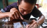 Die Silberschnitzerei im Dorf Dong Xam