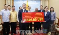Cộng đồng người Việt quyên góp ủng hộ người dân Lào gặp thiên tai