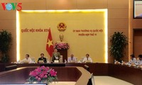 Top legislator chairs 11th session of the National Assembly Standing Committee