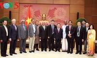 越南国会副主席汪朱刘会见国际合作社联盟亚太地区主席李春生