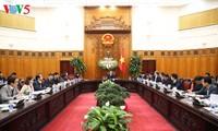 越南政府副总理武德担:动员社会资源参与社会民生工作