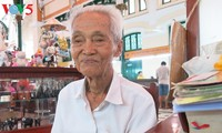 Duong Van Ngo, a public letter writer at the Saigon Central Post Office