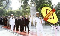 Top leaders pay tribute to national icon, martyrs on National Day