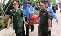 Truy điệu và an táng hài cốt liệt sĩ quân tình nguyện và chuyên gia Việt Nam hy sinh tại Lào