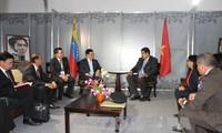 Phó Thủ tướng Phạm Bình Minh gặp Tổng thống Venezuela và Ngoại trưởng Iraq