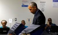 Обама досрочно проголосовал на выборах президента США