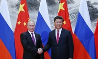China, Russia sign over 30 cooperative deals