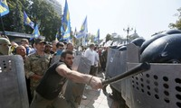 Ukraine police detain dozens in clashes outside parliament building