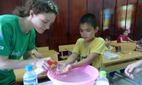 Community service day: teaching disabled children to wash hands