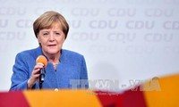 German Chancellor announces coalition talks with FDP, Greens