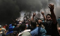 Gaza protests: dozens of Palestinians killed as US Embassy opens