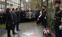 Paris commemorates Charlie Hebdo attacks