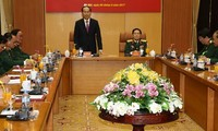 President Tran Dai Quang works with Defense Ministry leaders