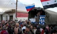 First humanitarian aid convoy arrives in Syria's Deir ez-Zor