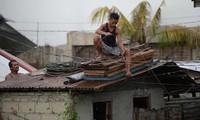 Massive storms devastate US, Philippines