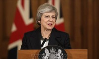 Theresa May vows to uphold draft Brexit deal