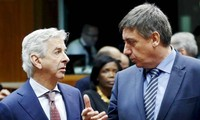 Brussels attacks: EU ministers pledge to share information, Belgium lowers its terrorism alert
