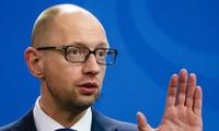 Ukraine's Prime Minister Arseny Yatseniuk announces resignation