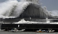 Powerful storms hit US, Japan