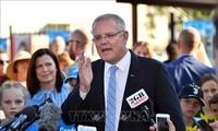Премьер-министр Австралии Моррисон празднует неожиданную победу на выборах