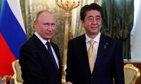 Putin, Abe reconfirm peace treaty