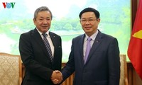 Vize-Premierminister Vuong Dinh Hue empfängt Vize-Präsident des Konzerns Mitsubishi Motors