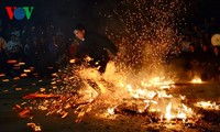 Barefoot Dao men dance on red hot charcoals