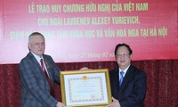 Russian official honoured for 10-year dedicated services