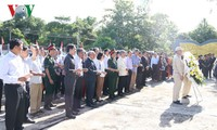 Offering incense to martyrs at Laos-Vietnam coalition force cemetery