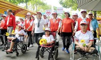 People walk for AO victims, disabled people
