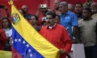Venezuelan President urges armed forces to defend democracy