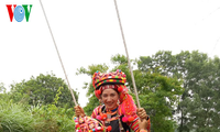 Swinging, an indispensable game of the Ha Nhi's rain Festival