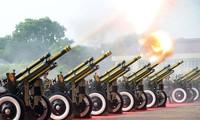 Meeting, parade militaire et défilé en l'honneur de la Fête nationale vietnamienne