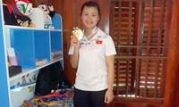 Atlet Quang Thi Thu Nghia-Gadis emas pencak silat dari etnis minoritas Thai