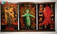 漆絵で「ベトナム人の三府の聖母崇拝」を紹介