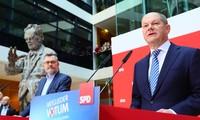 Allemagne: les sociaux-démocrates valident une coalition avec Merkel