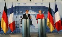 Zone euro et migrants: Macron et Merkel affichent leur unité