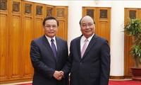 Nguyên Xuân Phuc reçoit le président du Front d'Édification nationale du Laos