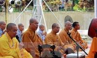 Mega upacara mendoakan arwah dan menyalakan lilin mengenangkan jasa para martir