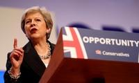 Royaume-Uni: Theresa May appelle à l'unité et enterre l'austérité