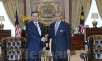 Der Minister für öffentliche Sicherheit To Lam besucht Malaysia